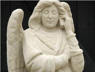 ангел с мобильным телефоном